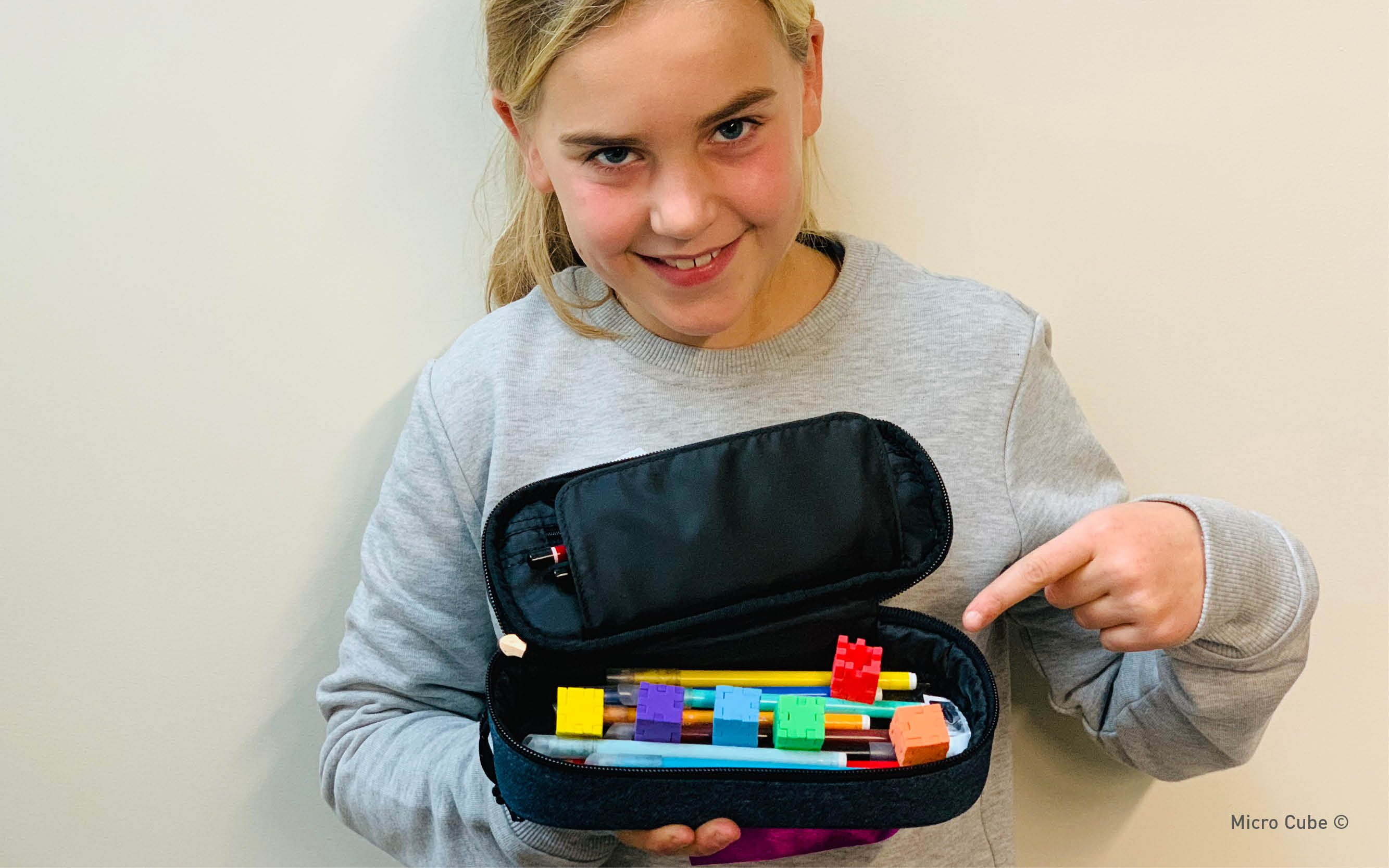 Happy_MicroCube_6-pack2_toy_in_classroom_pencil_case